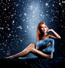 Sexy girl in underwear on a Christmas background with snow