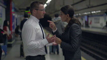 Businesspeople having quarrel on platform, slow motion,steadycam