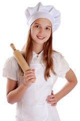 Girl dressed as a cook holding a rolling pin