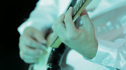 Close-up: Man Playing Guitar