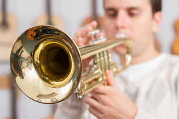 Young musician playing a trumpet