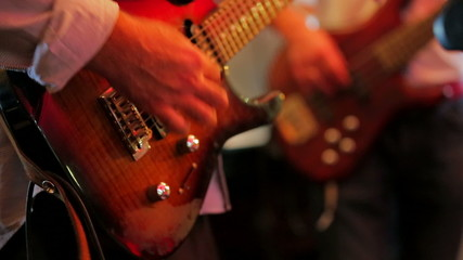 Two Guitarists Playing Guitar . Close-up