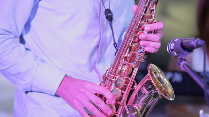 Musician Playing Saxophone. Close-up