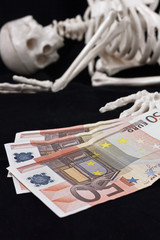 Skeleton and money