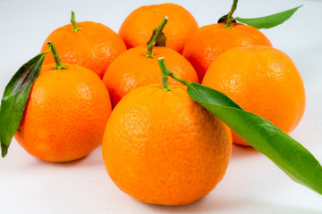 some sweet tangerines  on white