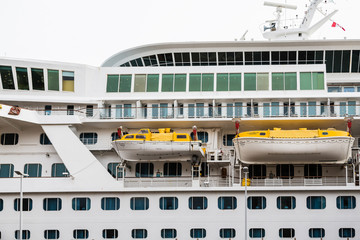 Two Yellow and White Lifeboats on Cruise Ship