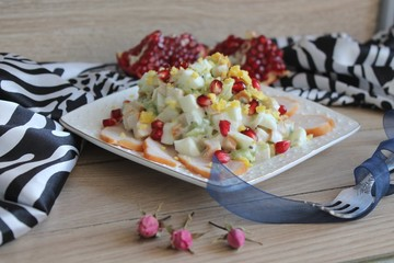 salad of smoked chicken breast with pomegranate and kiwi