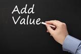 Writing the phrase Add Value on a Blackboard