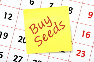 Reminder to buy seeds on a yellow sticky note
