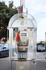 Modern public telephone on city street