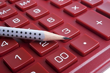 The calculator and pencil, close up
