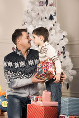 man gives his son New Year gift