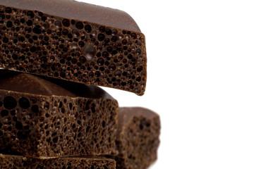 Porous dark chocolate, close-up