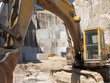 Постер, плакат: Escavatore in cava di granito