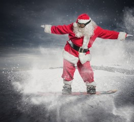 Santa Claus with snowboard