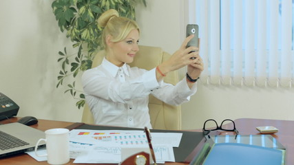 Attractive girl makes selfie on the phone