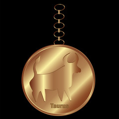 Bronze Charm for Taurus Over a Black Background