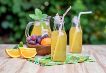 Fresh iced drinks with grapes and orange