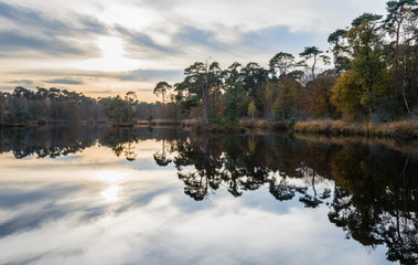 Autumnal colors reflected in a small lake