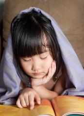 asian little girl be asleep under blanket