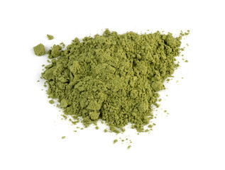 Macro closeup of organic wheatgrass powder isolated against whit