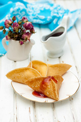 pancakes with jam on a light background