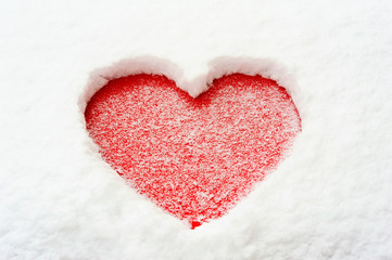 Valentine love red heart shape in snow on red car