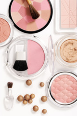 cosmetics on white with light shadows