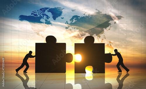 World Business teamwork puzzle pieces - 73155469