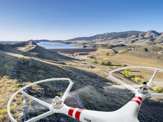 drone flying over mountain valley