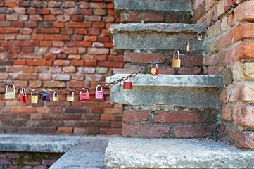 Locks of lovers on chain in romantic place