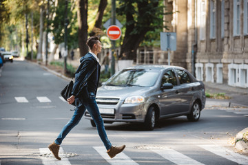 Young man cross the street