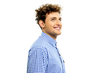 Smiling man with curly hair looking up
