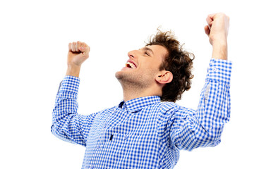 Happy man with raised hands up on a white background