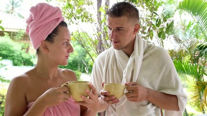 Couple Talking and Drinking Coffee after Shower in the Morning.