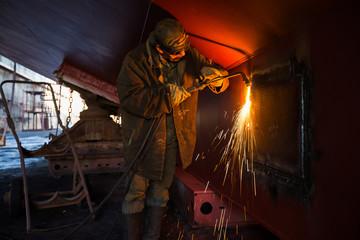 welder working at dock