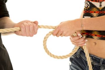 couple tug of war rope very close