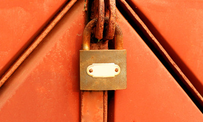 Lock on a rusty iron gate