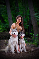 Girl with dogs at forest