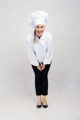 Young professional chef woman. Isolated over white background