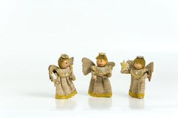 Three wooden angels on white background