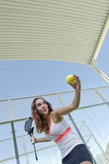 Paddle tennis woman ready for serve