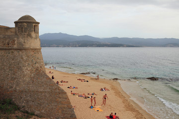 Beach under ancient fortress. Ajaccio, Corsica, France