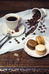 Coffee mood: cup of coffee, coffee beans and macaroons