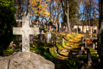 A cross monument in a cemetery