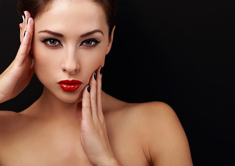 Beautiful makeup woman with red lips posing with hands
