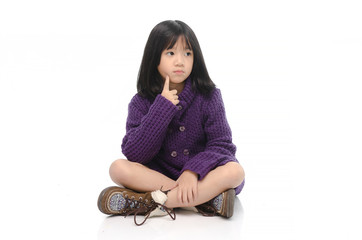 Little asian girl sitting and thinking