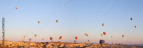 beautiful landscape with hot air balloons and mountains - 73167235