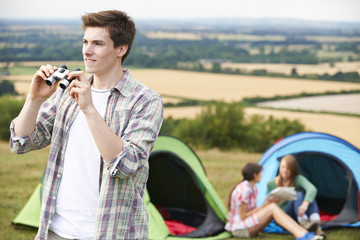 Group Of Young Friends Camping In Countryside