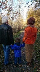 Grandfather, boy and grandma autumn